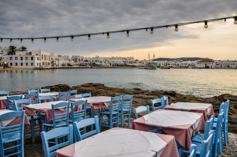 Blue Chairs Chair Chairs Empty Greece Harbour Harbour View Lights Mykonos Restaurant Sea Tablecloth Tables And Chairs Tavern  Tourism Touristic Pastel Power Pastel Colour Of Life Off Season Miles Away