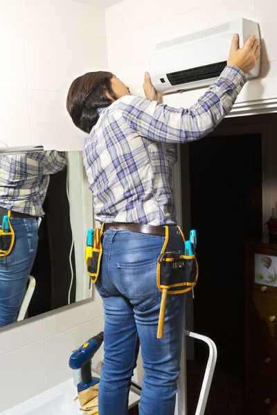 electrician woman installing heater Woman Ac Activity Busybody Drill Electrician  Factotum Hammer Handymake Handyman Heather Heating Indoors  Installer Level Repair Repair Woman Screwdriver Tool Tool Woman Tools Utility Woman Working