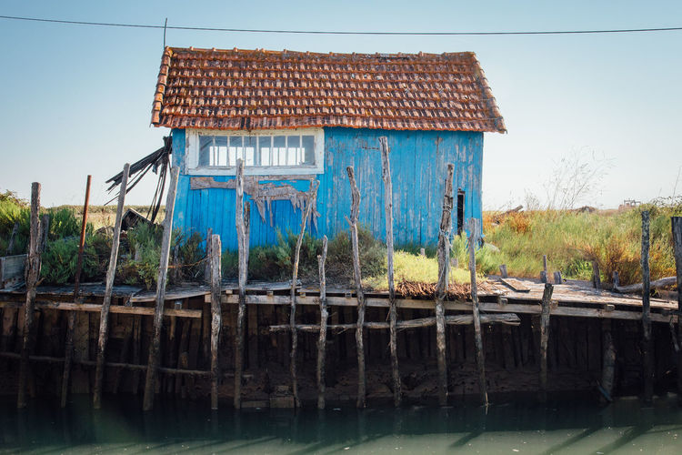 Oyster Farm Traditional Building Traditional Wooden Wood - Material Abandoned Stilt House Wood - Material House Sky Architecture Building Exterior Built Structure Hut Roof Tile Discarded Shack Calm Run-down Worn Out Weathered Bad Condition Damaged Obsolete Thatched Roof