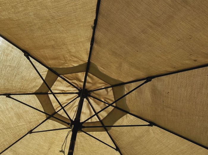 Low Angle View Of Beige Umbrella