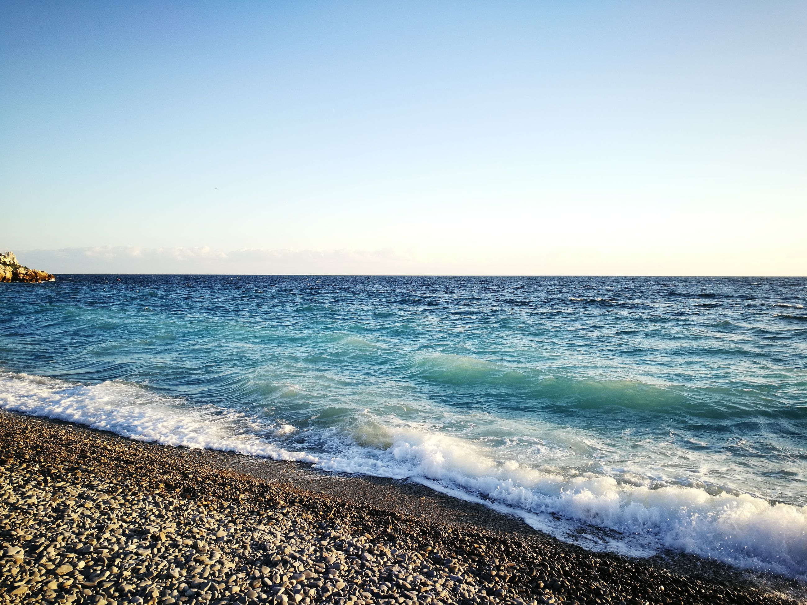 sea, water, nature, scenics, beauty in nature, horizon over water, clear sky, blue, tranquil scene, tranquility, no people, sky, outdoors, day, beach