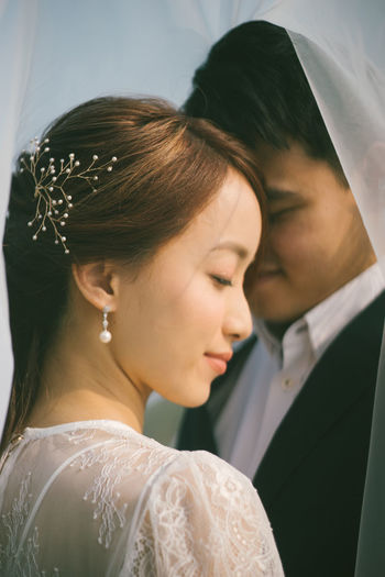 Wedding Newlywed Bride Young Adult Women Celebration Real People Life Events Wedding Dress Event Young Women Love Ceremony Adult Headshot Couple - Relationship Wedding Ceremony Emotion Two People Bridegroom Positive Emotion Beautiful Woman Bride And Groom Wedding Day Asian  Asian Girl Asian Boy