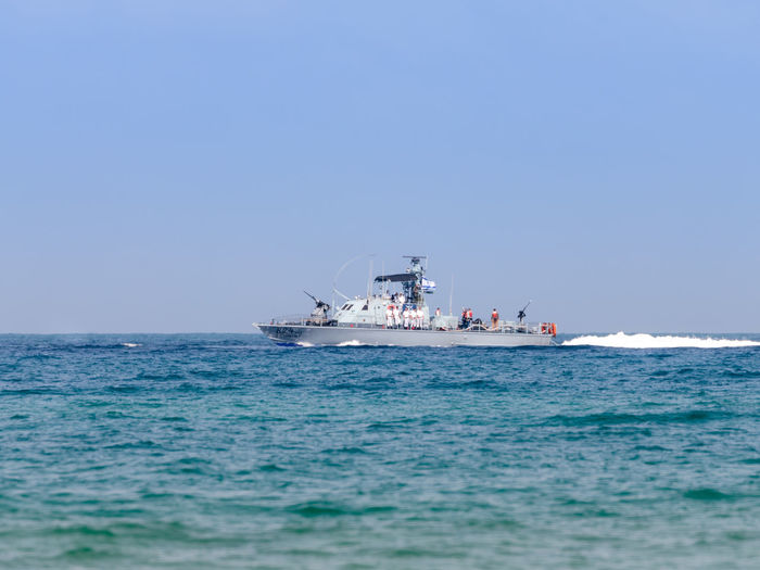 Haifa, Israel - April 19, 2018 : A combat ship is participating in a maritime parade off the coast of Haifa in honor of the 70th anniversary of the independence of the State of Israel 70th Anniversary Of The Independence Of The State Of Israel Celebration Event Force Freedom Haifa Israel National Naval Patriotic Soldier Battleship Combat Ship Combat Submarine Day Flag Maritime Parade Military Nautical Vessel Navy Police Boat Sea Ship Sky Warship Water