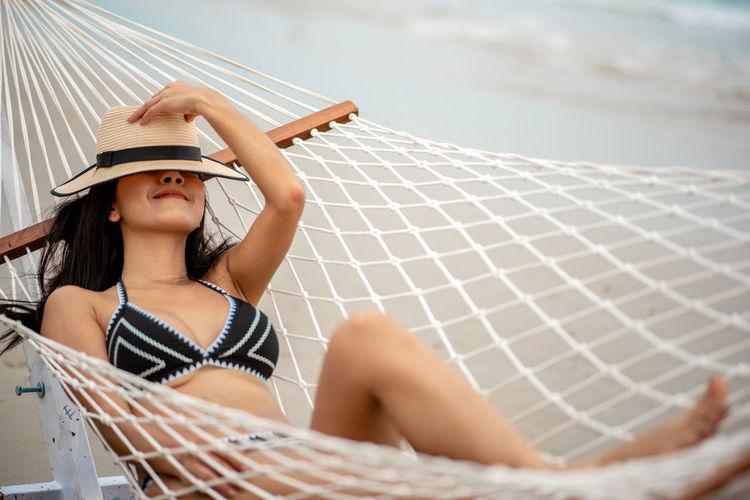 One Person Real People Hat Leisure Activity Lifestyles Clothing Women Sitting Young Adult Adult Young Women Day Sun Hat Looking Focus On Foreground Females Outdoors Nature Beautiful Woman