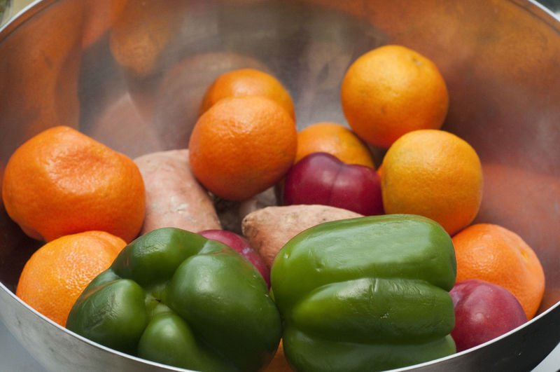 Close-up of fruits and vegetable in container