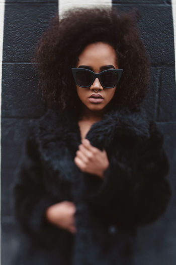 African American Afro Black Woman Adult Beautiful Woman Beauty Clothing Curly Hair Fashion Front View Glasses Hair Hairstyle Leisure Activity Lifestyles Looking At Camera One Person Portrait Real People Sunglasses Teenager Warm Clothing Women Young Adult Young Women