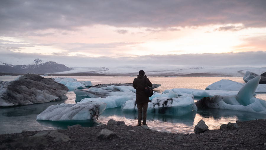 Iceland Roardtrip: jökulsárlón Jökulsárlón Beauty In Nature Cloud - Sky Cold Temperature Full Length Ice Leisure Activity Lifestyles Nature People Real People Rear View Scenics - Nature Sea Sky Snow Standing Sunset Tranquil Scene Tranquility Water