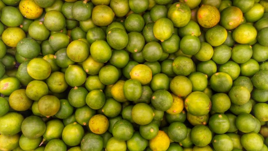 Full Frame Shot Of Limes At Market Stall