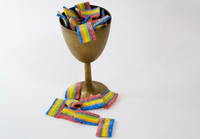 A holy supper chalice with rainbow candies. Candyshop Sacrament Tolerance Candy Close-up Dessert Food Food And Drink Freshness Gay Homosexual Love Indulgence Lgbt Multi Colored No People Pride Ready-to-eat Religion Still Life Sweet Food Sweets Temptation Theology Unhealthy Eating White Background goblet