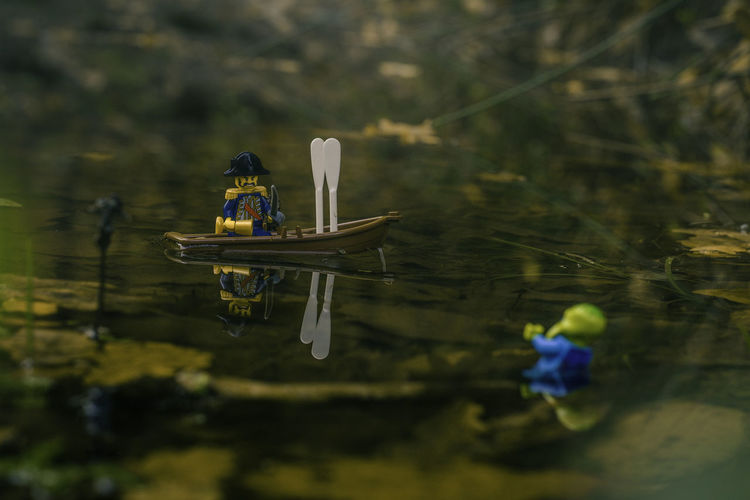 Captain Yellow Beard versus Swamp Thing. [17/365] 365project Autumn Captain Close-up Cthulhu Dark Day Figures Forest Grass Lake Leaves LEGO Lego Minifigures Legophotography Nature Nautical Vessel No People Outdoors Pirate Puddle Reflection Swamp Toys Water