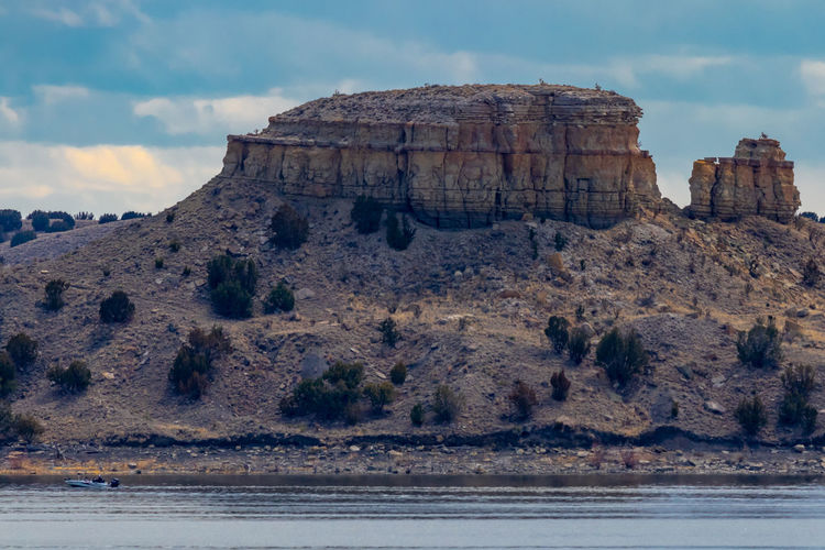 Plateau by lake Rock Sky Rock - Object Rock Formation Solid Water Nature Scenics - Nature Beauty In Nature Land Tranquil Scene Tranquility Cloud - Sky No People Day Non-urban Scene Sea Mountain Travel Outdoors Eroded