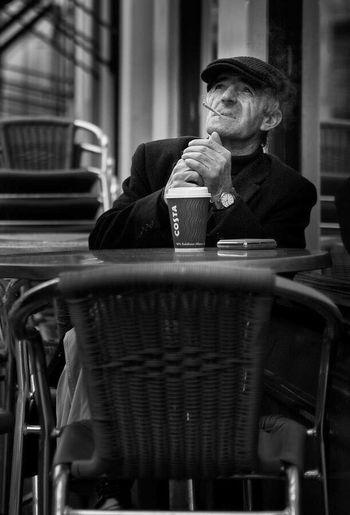 Was that rain? Upclose Street Photography Coffee Streetphotography Coffeeshop Coffee And Cigarettes Glasgow  Blackandwhite Monochrome Up Close Street Photography Upclosestreetphotography