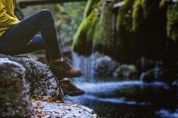 Nature Adventure Body Part Day Flowing Water Focus On Foreground Human Body Part Human Foot Human Leg Human Limb Leisure Activity Lifestyles Low Section Moss Nature One Person Outdoors Real People Rock Rock - Object Shoe Solid Water