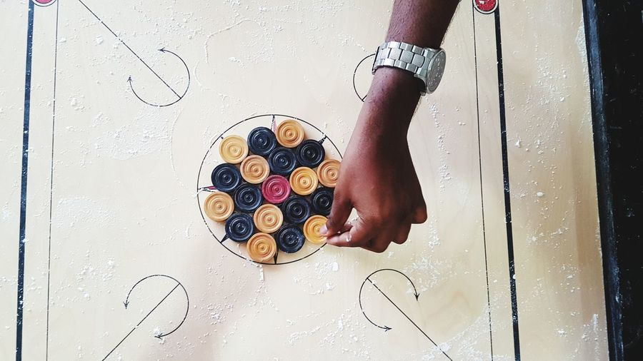 Game Indoor Game Carrom Board Coins Playing Human Hand Child Directly Above Creativity Close-up A New Beginning