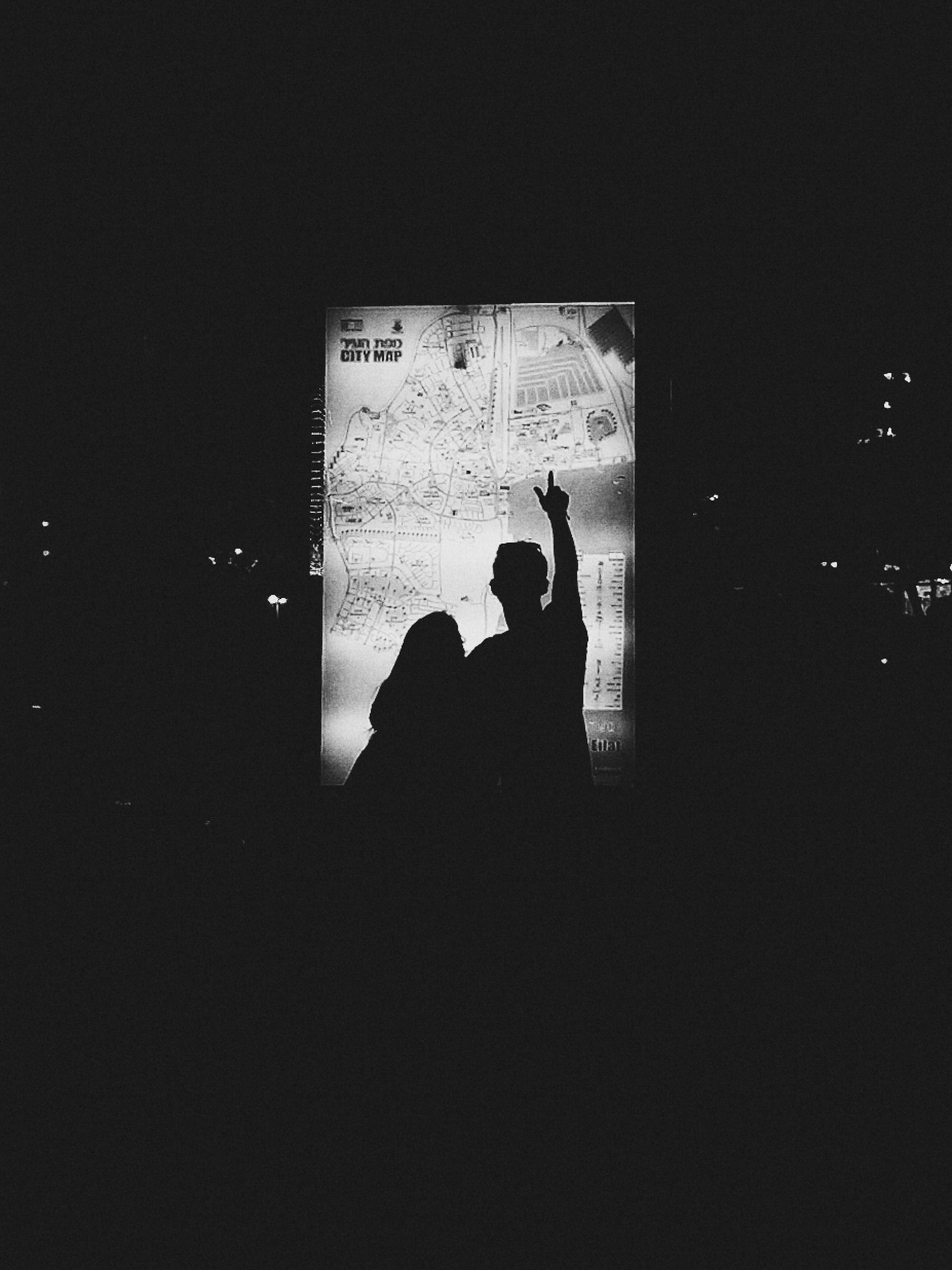 lifestyles, men, leisure activity, silhouette, indoors, communication, togetherness, night, copy space, text, standing, dark, bonding, person, love, photographing, rear view