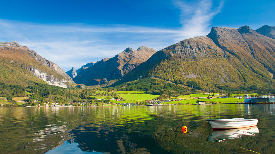 The small town of Innfjorden in Norway Beauty In Nature Calm Cloud Day Idyllic Lake Landscape Majestic Mountain Mountain Range Nature Outdoors Rippled Scenics The Great Outdoors - 2016 EyeEm Awards Tranquil Scene Tranquility Water