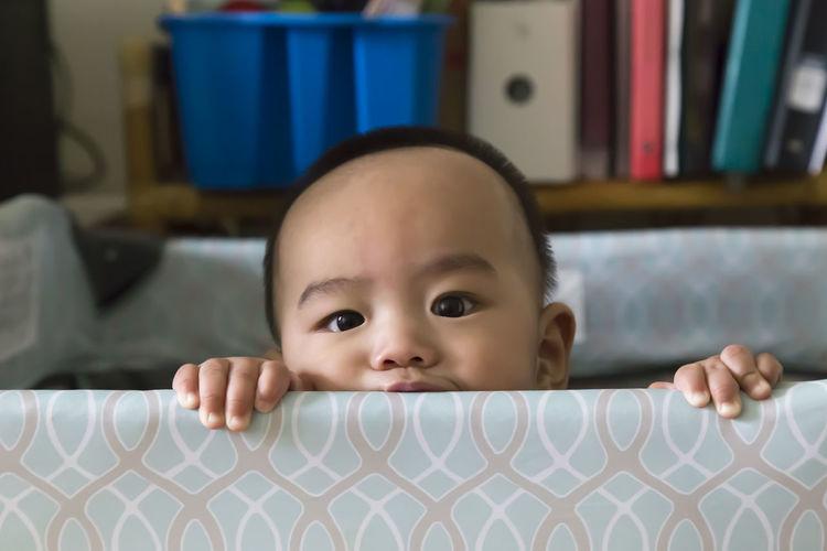Portrait of boy in crib