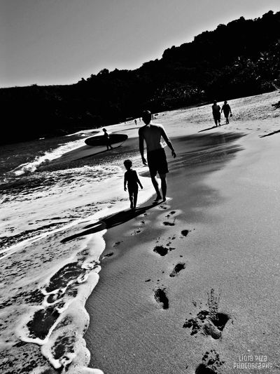 Fatherhood Moments Walking Full Length Beach Tranquil Scene Clear Sky White Sand Surfboard Snow Covered Tranquility Mountain Vacations Nature Sunny Sky Scenics Cloud Sea Photography Photooftheday Blackandwhite EyeEm Gallery Family People And Places