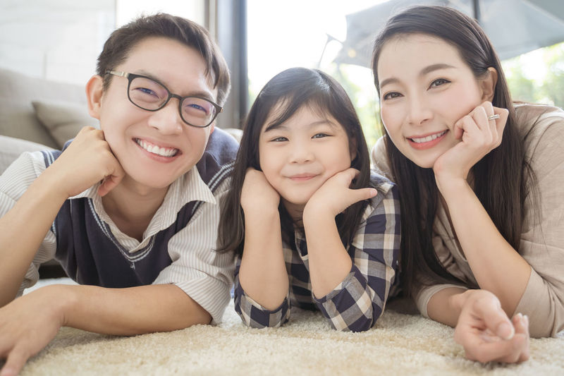 happy asian family spending time together on sofa in living room. family and home concept Asian  Family Happiness Happy Happy People Family Time Home House Daughter Parent Father Mother Dad Mom Love Lifestyles Living Room ASIA Japanese  Korean Thai Taiwan Smiling Smile Fun Portrait Girls