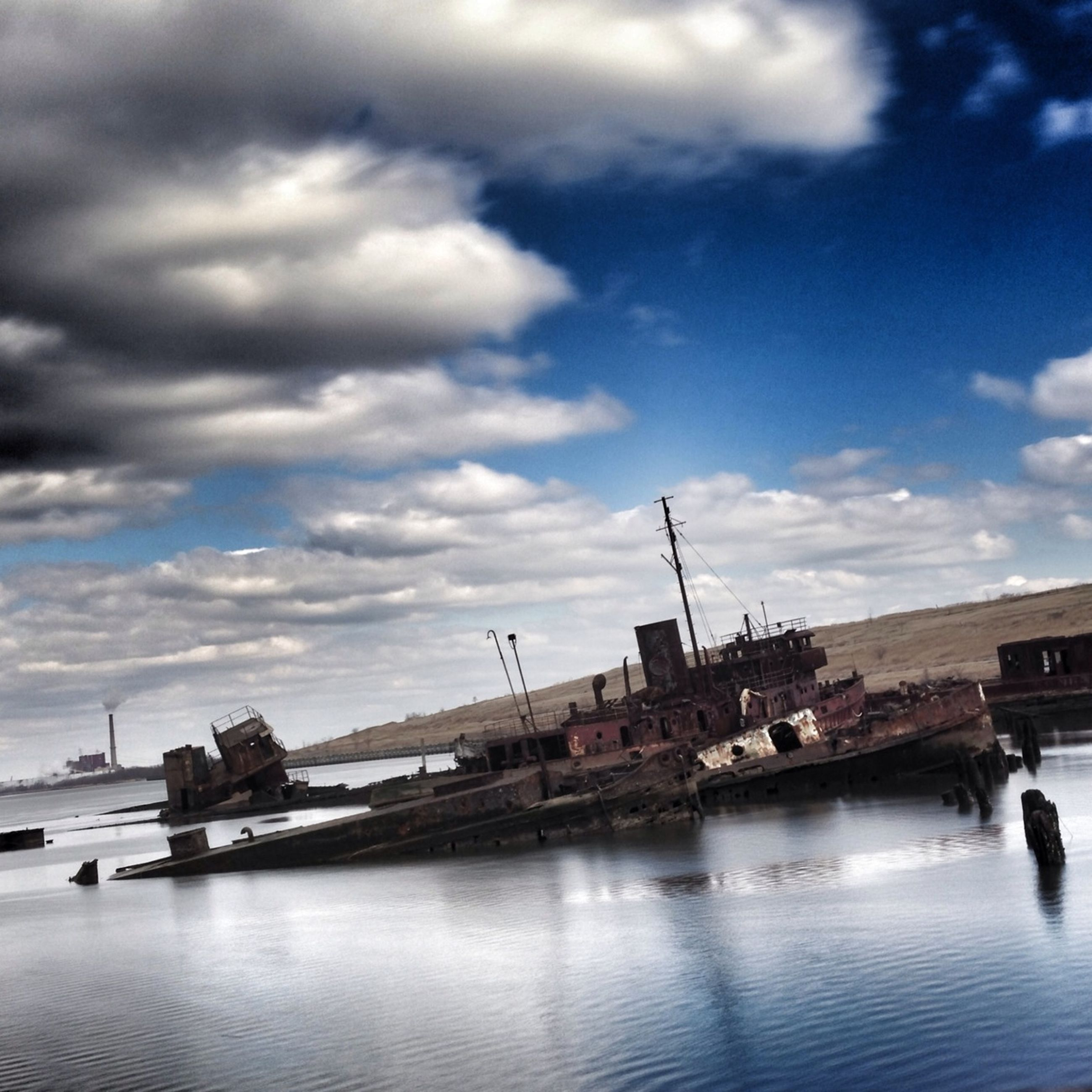 water, sky, built structure, architecture, cloud - sky, waterfront, building exterior, river, cloudy, cloud, connection, transportation, harbor, sea, nature, nautical vessel, day, outdoors, bridge - man made structure, no people