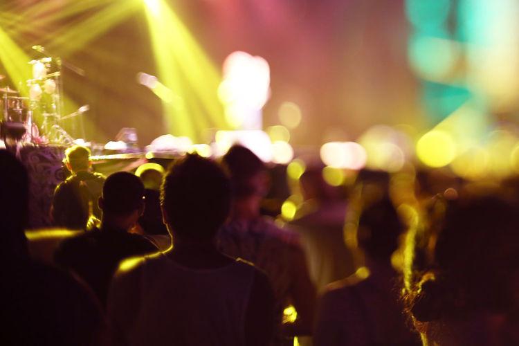 Defocused image of crowd at music concert