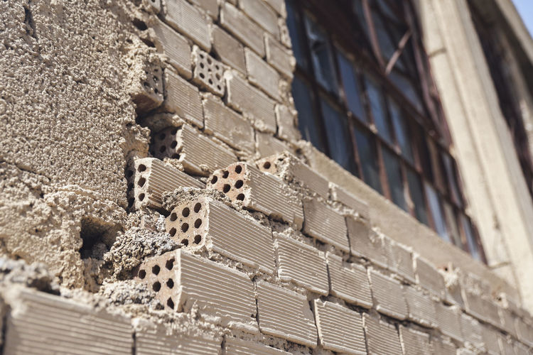 Unfinished Under Construction... Abandoned Abandoned Buildings Architecture Brick Bricks Broken Building Building Exterior Built Structure City Close-up Cold Temperature Day Low Angle View No People Outdoors Pattern Residential District Selective Focus Sunlight Unfinished Wall - Building Feature Window