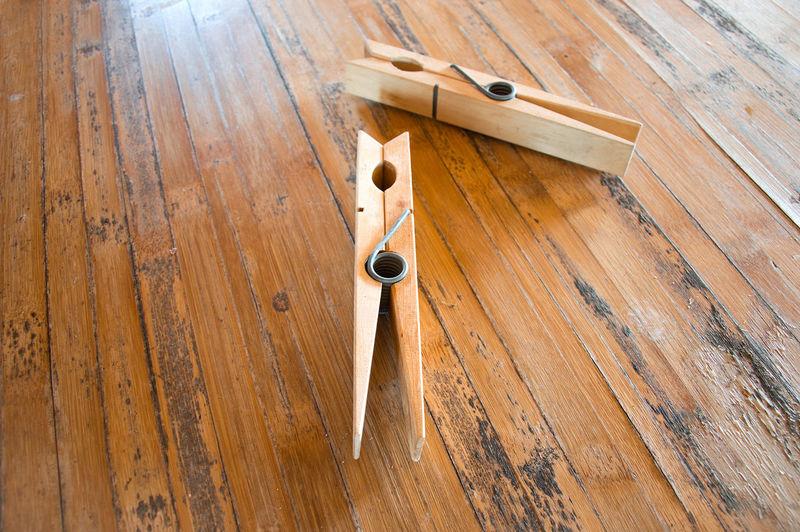 Close-up of work on hardwood floor