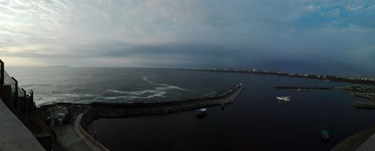 Panoramic view of sea against dramatic sky