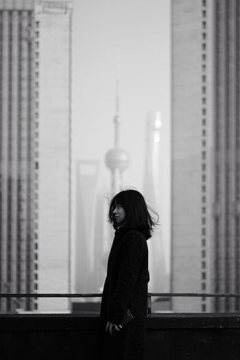 Monochrome Blackandwhite Cityscape Portrait Of A Woman Portrait One Person Real People Leisure Activity Focus On Foreground Lifestyles Architecture Go Higher Go Higher