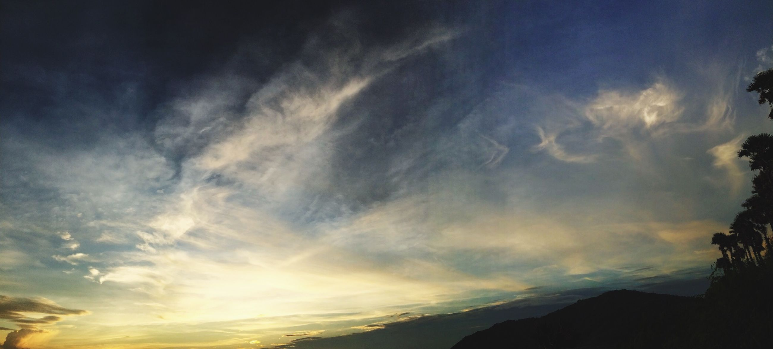 scenics, sky, tranquil scene, beauty in nature, tranquility, sunset, cloud - sky, silhouette, nature, landscape, idyllic, cloudy, cloud, mountain, dramatic sky, cloudscape, outdoors, weather, dusk, no people