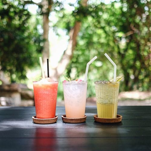 Drinking Straw Focus On Foreground Freshness No People Refreshment Drink Food And Drink Table Drinking Glass Day Outdoors Healthy Eating Close-up Smoothies Garden Starting The Day Nature Refreshment Relaxing Green Chilling