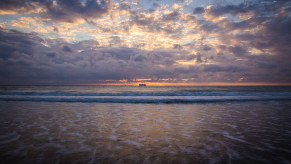 Sunset Sea Beach Dramatic Sky Cloud - Sky Nature Water Scenics Beauty In Nature Reflection Landscape Vacations Tranquility Outdoors Tranquil Scene No People Horizon Over Water Travel Destinations Sun Summer 3XSPUnity