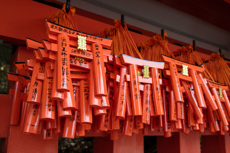 Mini Torii Gates hanging, Kyoto Japan. Fushimi Inari-taisha Japan Japanese  Japanese Culture TORII Torii Gate Travel Close-up Day Fushimi Inari Shrine Hanging Kyoto Low Angle View No People Orange Color Place Of Worship Red Religion Souvenir Souvenirs Spirituality Torii Gates Travel Destinations Wood - Material