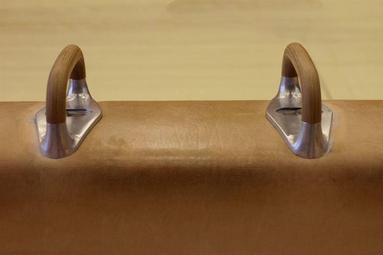 High angle view of eyeglasses on table against wall