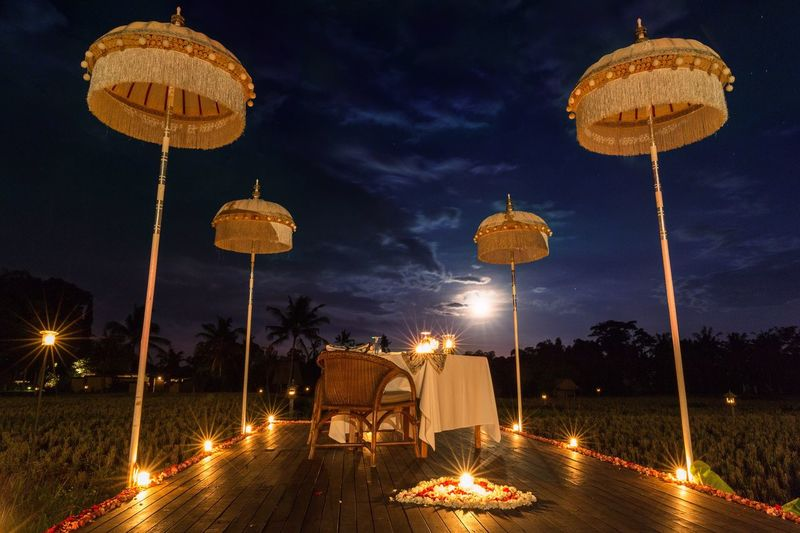 Balinese candle light dinner in the rice fields at Chedi Club, Ubud Feel The Journey Bali Resort thechediclubtanahgajah
