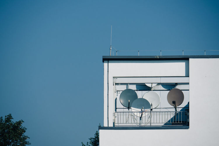 Low angle view of satellite dishes in terrace of a building