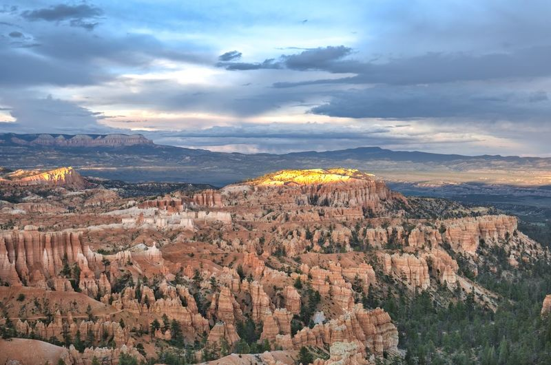 Amphitheatre Beauty In Nature Bryce Canyon Cliff Cloud - Sky Dramatic Landscape Enjoying The View Geology Hoodoos Idyllic Landscape Majestic Mountain Mountain Range Nature Non-urban Scene Panoramic View Physical Geography Red Remote Rock Formation Scenics Sunset Travel Destinations Utah