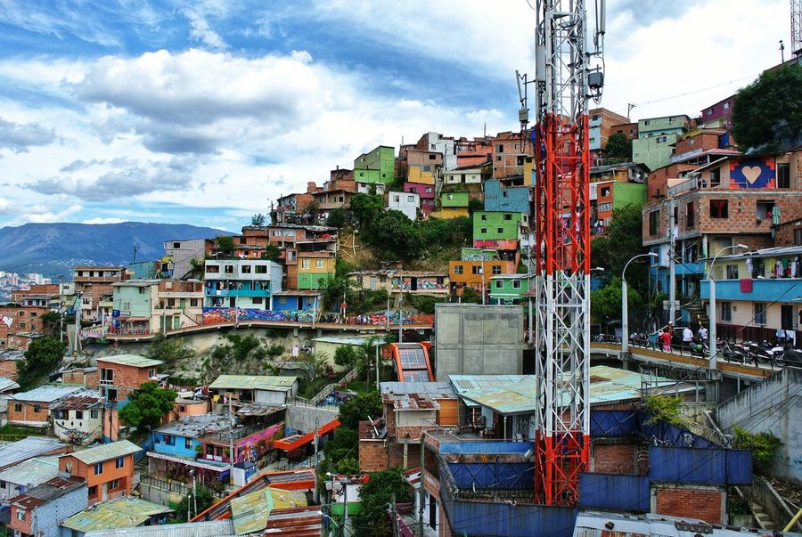 Comuna 13, Medellin. 🇨🇴 Colombian  Architecture Architecture_collection Mountain Sky And Clouds San Javier EyeEmNewHere Escalator Farc Pablo Escobar Comuna 13 Barrio Medellín Colombia Antioquia Graffiti Streetart Streetphotography Colorful Southamerica Latin America City Cityscape Multi Colored City Street Sky Architecture Building Exterior Ghetto Spray Paint