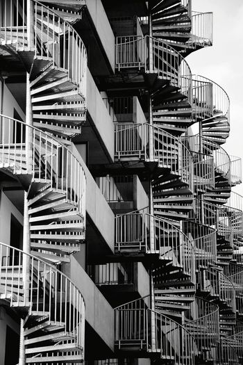 Black and White. Railings Railing Line Architecture Outdoor Photography Day Sunlight Sunshine Facade Building Facade Detail Façade Architecturale Facade Design Architecture Details Spiral Staircase Fire Escape Steps And Staircases Steps Staircase Urgency Safety Railing Backgrounds Architecture Emergency Exit Spiral Stairs Stairs Hand Rail