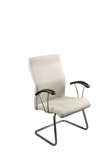 Close-up of empty chair against white background