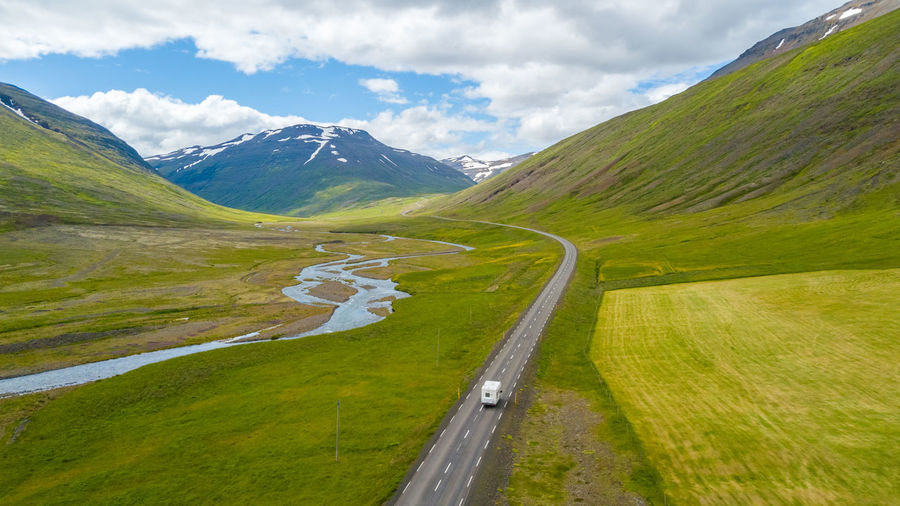 Iceland Traveling Beauty In Nature Camper Van Cloud - Sky Day Grass Green Color Journey Landscape Long Motor Home Mountain Mountain Range Nature Non-urban Scene Outdoors Road Road Trip Scenics - Nature Sky Tranquil Scene Tranquility Transportation Travel Destinations