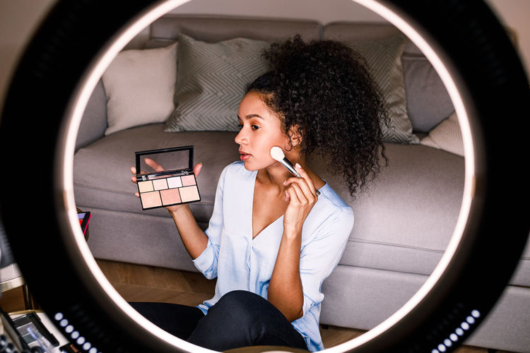 DSLR Camera Equipment Vlogger Fashion Makeup Tutorial E-commerce Marketing Indoors  Filming Content Social Media Ring Light Woman Young Screen Blogger Channel Looking Review Lifestyle