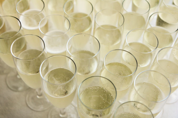 Group of champagne glasses Bubbly Celebration Champagne Wedding Reception Arrangement Cava Champagne Flute Close-up Drink Drinking Glass Food Food And Drink Freshness Glass Glass - Material High Angle View In A Row Indoors  Large Group Of Objects No People Order Prosecco Refreshment Still Life Table