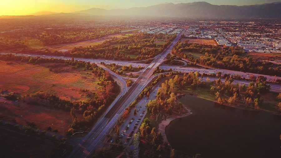 Aerial View Of Multiple Lane Highway On Landscape During Sunset
