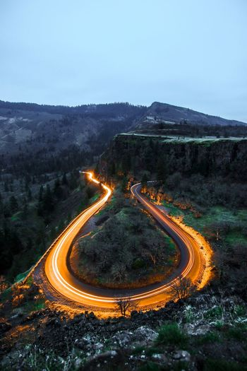 Light up the way United States Oregon Sky Illuminated Nature Night Road Long Exposure Mountain Transportation High Angle View Light Trail Motion Landscape Outdoors