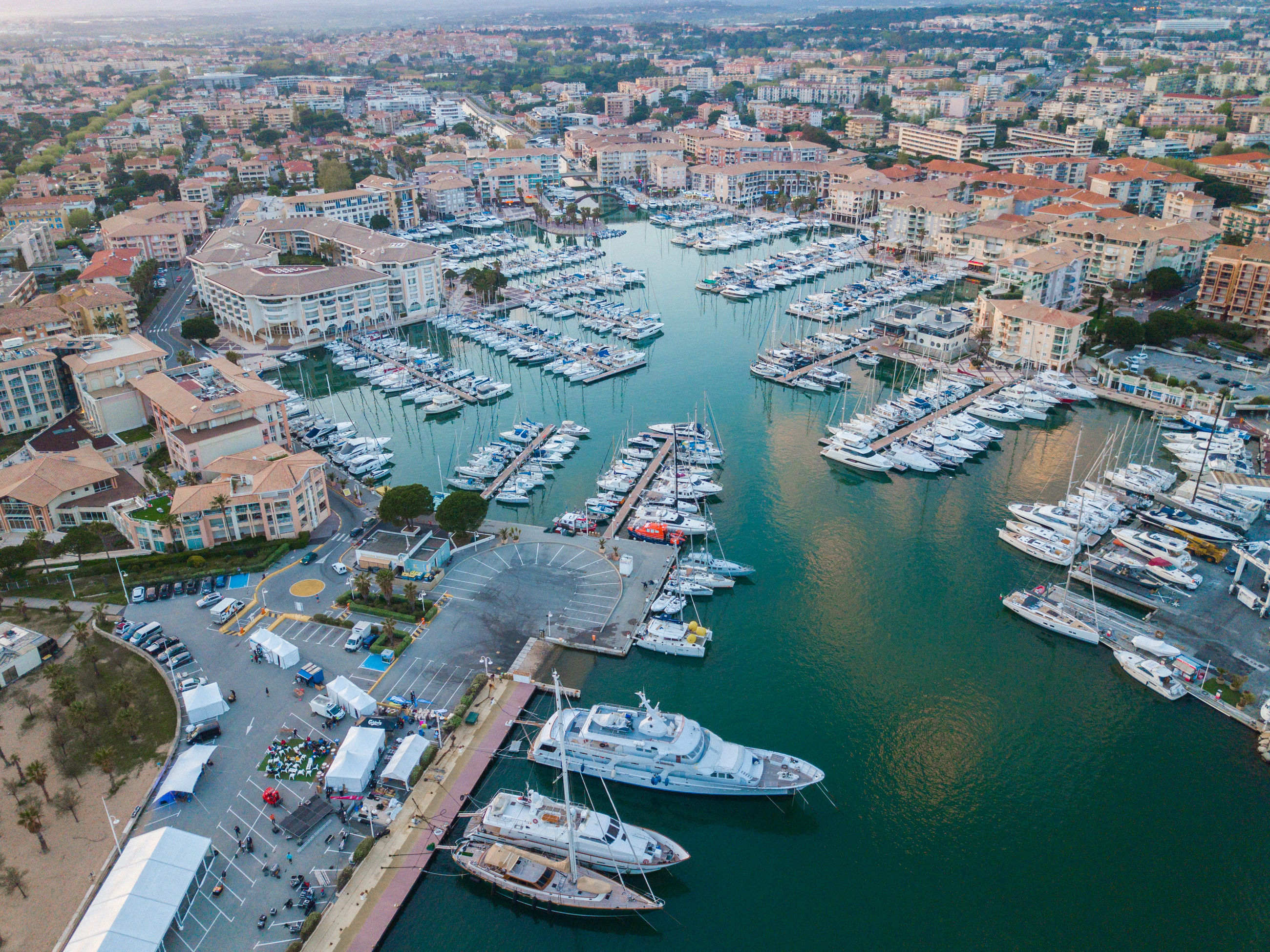 transportation, water, high angle view, nautical vessel, architecture, city, building exterior, aerial view, built structure, mode of transportation, cityscape, harbor, nature, no people, sea, day, travel, travel destinations, ship, outdoors, sailboat