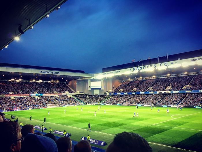 Ibrox at Night, Glasgow, Scotland Ibrox Football Sport Stadium Group Of People Crowd Large Group Of People Soccer Night Team Sport Spectator Grass Playing Field Real People Soccer Field Sky Blue Illuminated Watching