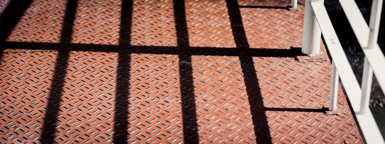 A shadow of pole stand on the walk way path, steel path, pattern of Sunny and shadow. Construction Light Path Sunny Textured  Background Backgrounds Building Close-up Color Day Detail Floor Full Frame Indoors  Light And Shadow Material No People Old Pathway Pattern Shadow Structure Summer Texture