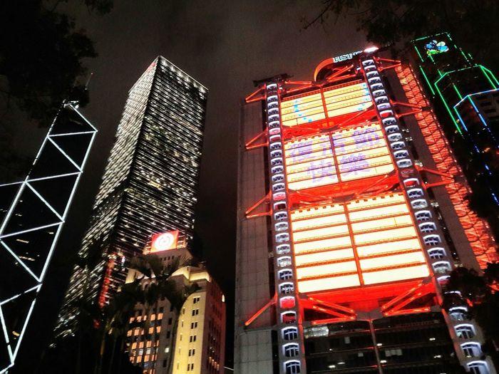 Financialdistrict  Neon Lights Illuminated HSBC Boc SCB Central City Illuminated Skyscraper Architecture Sky Building Exterior Built Structure