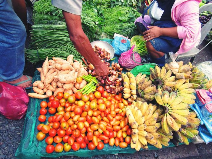 Local market day. Food And Drink Food Freshness Market Vegetable For Sale Healthy Eating Selling High Angle View Retail  Variation Market Stall Large Group Of Objects Abundance Display Fruit Choice Men Customer  Collection Beautifully Organized